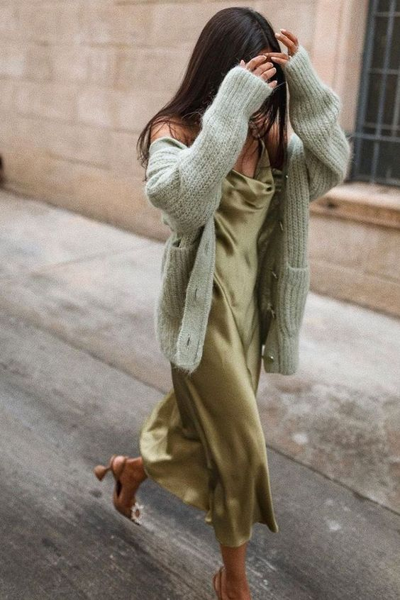 a gorgeous outfit with a green slip midi dress, a light green chunky cardigan, brown embellished heels for a date or party