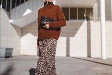 18 a leopard print midi skirt, a rust-colored sweater, black boots and a black clutch for a super elegant fall look