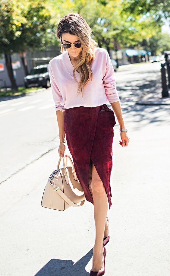 a refined work lookw ith a pink jumper, a burgundy suede wrap midi skirt, burgundy heels and a tan bag