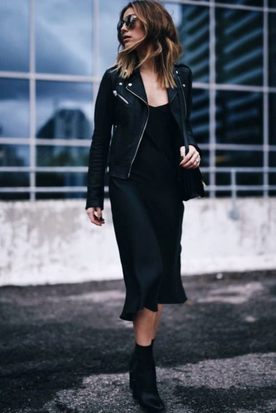 a classy fall total black look with a slip midi dress, a leather jacket, boots and a bag is a timeless idea