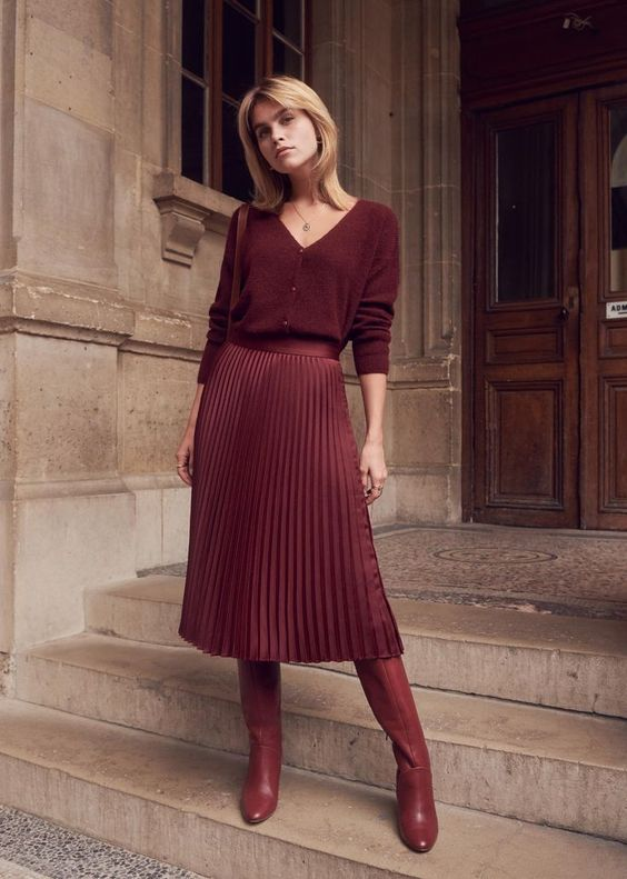 a simple and pretty fall work outfit in burgundy - a pleated midi skirt, a cardigan as a shirt, boots and a bag