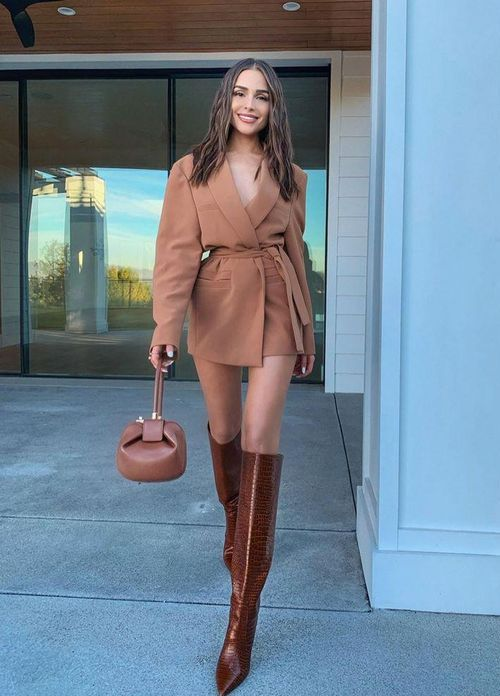 a feminine fall outfit with a blazer mini dress, chocolate brown knee high boots and a small brown bag