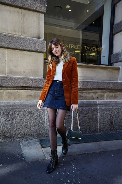 a pretty fall outfit with a white jumper, a navy denim mini, black tights and boots, a rust-colored corduroy blazer and a green bag