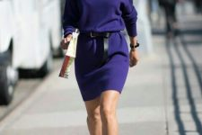 20 a purple knit midi dress with a black leather belt, black sock boots and a watch for a statement look