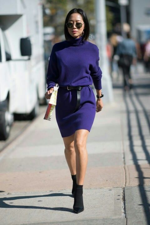 a purple knit midi dress with a black leather belt, black sock boots and a watch for a statement look