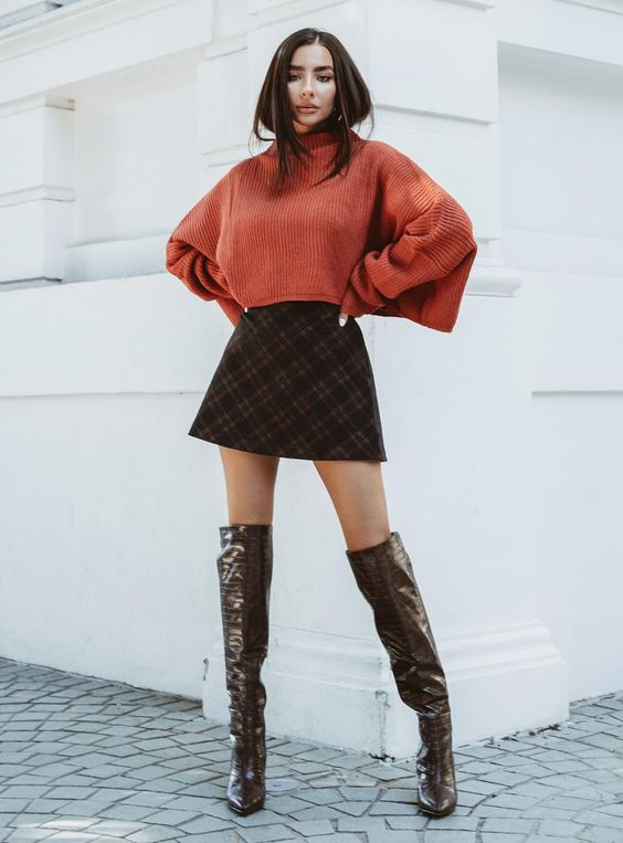 a rust oversized cropped sweater, a brown plaid A-line mini skirt, brown over the knee boots for a sexy look