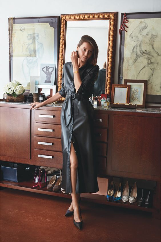 a beautiful black elather shirtdress of midi length, with short sleeves and black pumps for ultimately elegant look