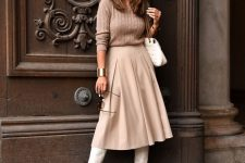 23 a tan patterned jumper, a creamy leather pleated midi skirt, white boots and a white bag for a very girlish fall date look