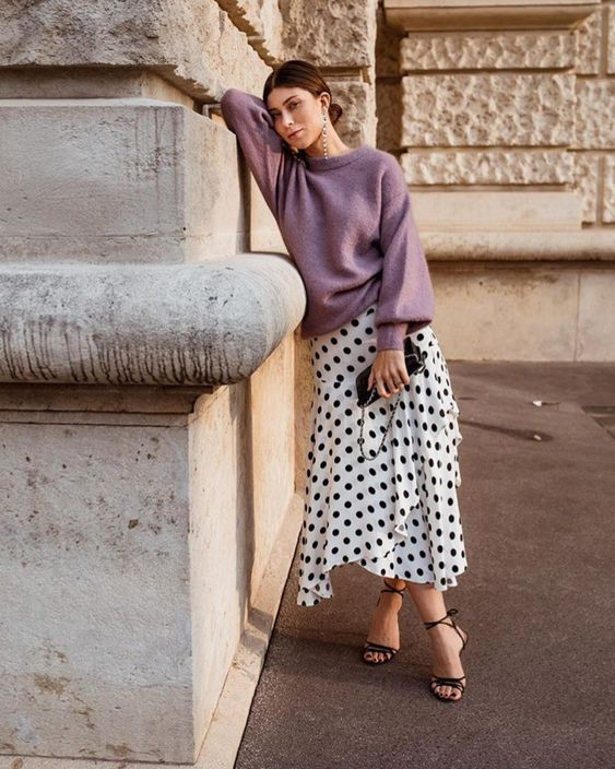 a romantic fall date look with a lavender oversized sweater, an asymmetrical polka dot skirt, black lace up heels and a clutch