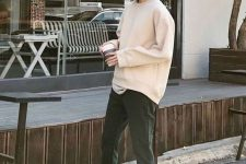 24 a white t-shirt, a creamy sweatshirt over it, dark green trousers, black sneakers for a simple and cool college look