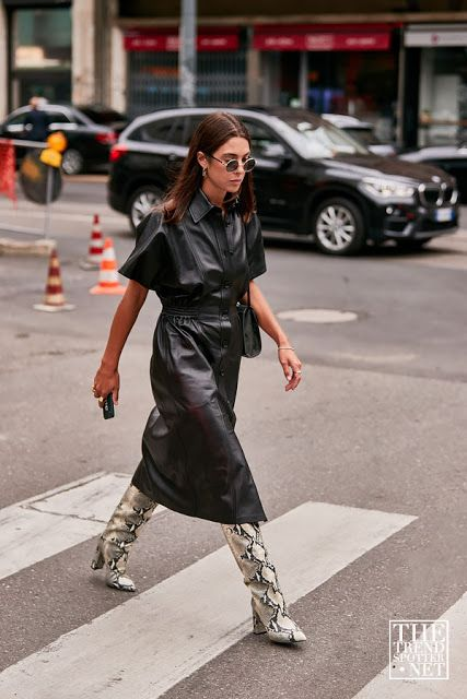a lovely outfit of a black leather shirtdress, snakeskin print tall boots, a black mini bag is cool