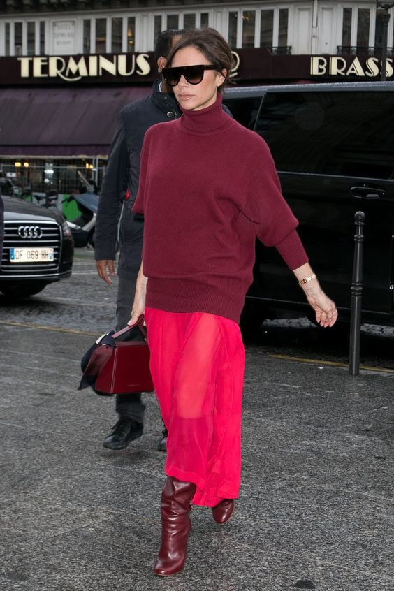 a super catchy outfit with an oversized burgundy sweater, a hot pink semi sheer skirt, burgundy boots and a bag
