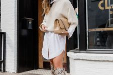 25 a white mini shirtdress, a creamy cropped jumper, snakeskin printed knee boots and a tan bag