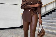 25 an oversized brown shirt, matching leather pants, black heels and a brown and tan zebra print mini bag