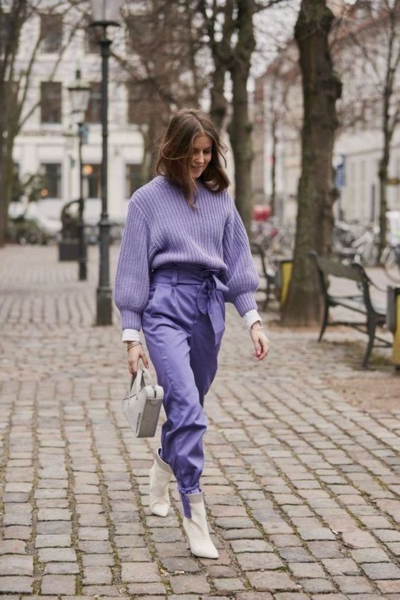 a monochromatic outfit with an oversized lavender sweater, high waisted trousers, white boots and a white bag