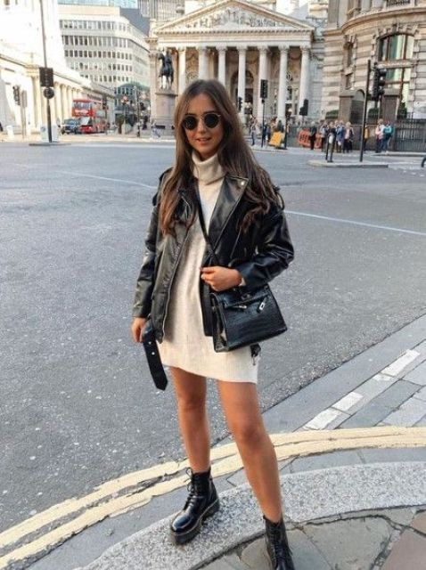 a white mini sweater dress, a black leather jacket, black combat boots and a bag for a comfy and sexy look