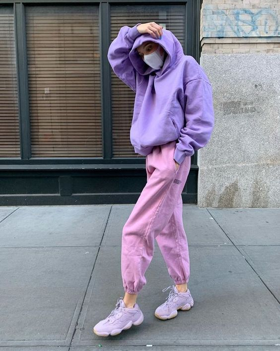 a pastel fall look with a purple hoodie, pink sweatpants, lilac trainers is a cool and unexpected idea