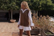 27 a white shirtdress, a brown knit vest, burgundy combat boots compose a cool outfit for a fall date