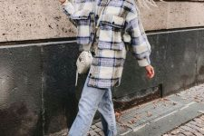 27 a white turtleneck, an oversized plaid shirt jacket, blue jeans, white sneakers and a white bag to switch to a tote