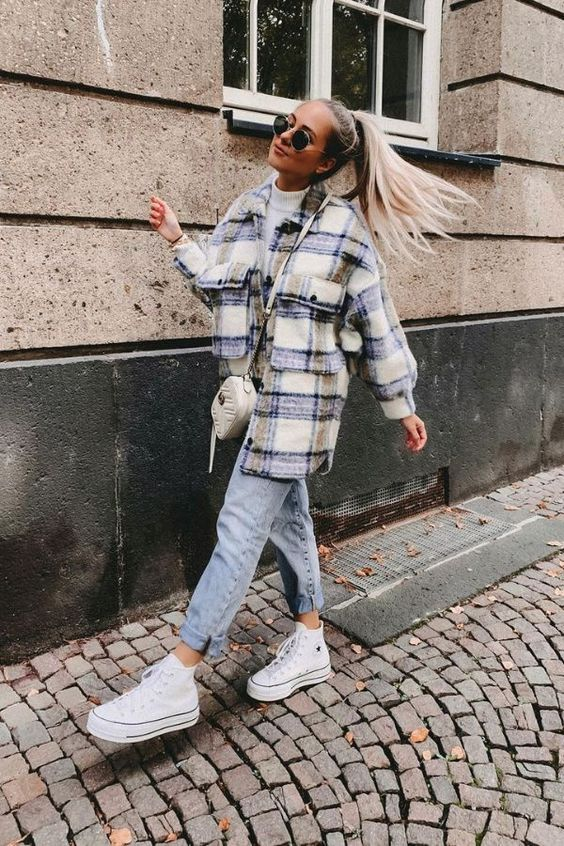 a white turtleneck, an oversized plaid shirt jacket, blue jeans, white sneakers and a white bag to switch to a tote