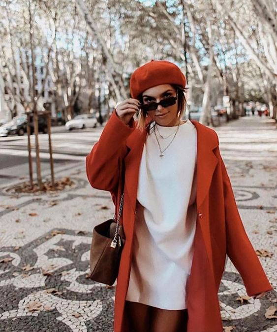 a white mini dress, a rust coat, a rust beret, a brown bag and layered necklaces are amazing for the fall