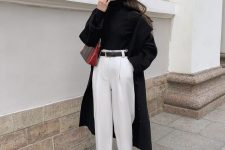 29 a black turtleneck, white trousers, a black belt and snekaers, a black trench and a bold mini bag for a contrasting look
