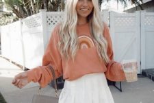 30 a coral rainbow print sweatshirt, a white tennis skirt, a grey mini bag for a girlish college look