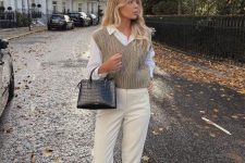 31 a preppy college look with a white shirt, a grey patterned crop knit vest, creamy pants, white sneakers and a black bag