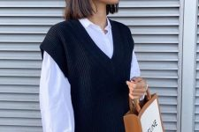 34 a white oversized shirt, a black sweater vest, black leather pants are all you need for a modern and edgy look
