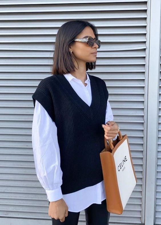 a white oversized shirt, a black sweater vest, black leather pants are all you need for a modern and edgy look