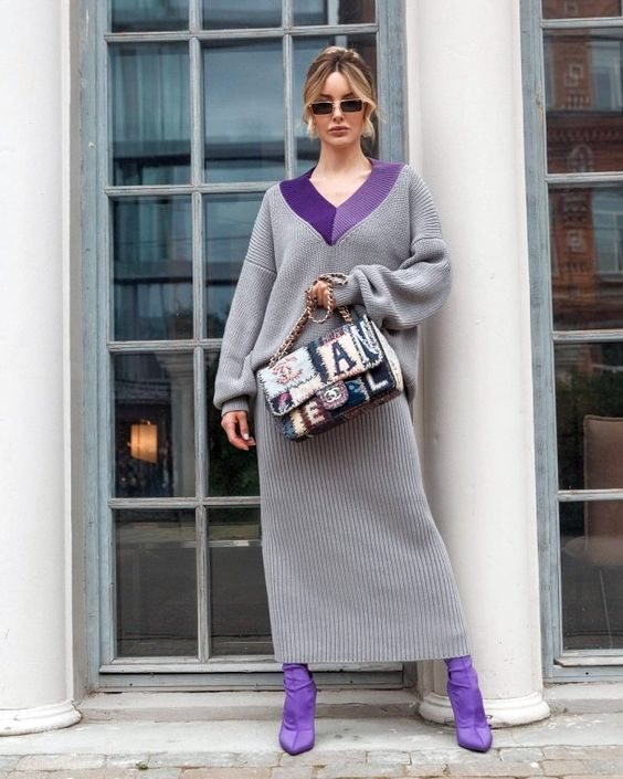 a whimsy outfit with a grey maxi sweater dress with a purple neckline, matching sock boots and a whimsy bag