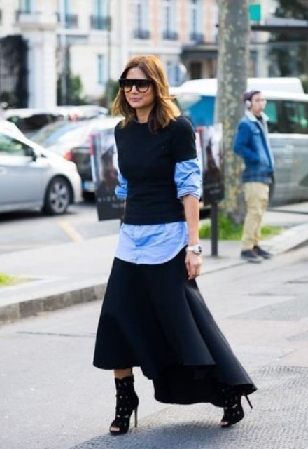 With asymmetrical maxi skirt, black cutout high heeled boots and sunglasses