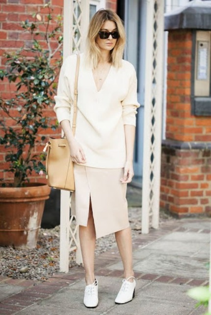 With beige asymmetrical skirt, beige leather tote bag and white shoes