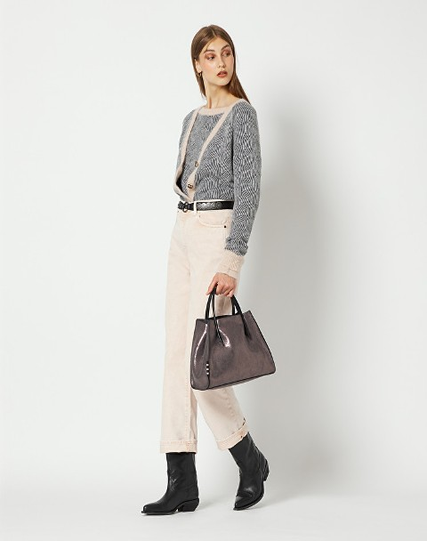 With beige cropped trousers, patent leather bag and black low heeled boots