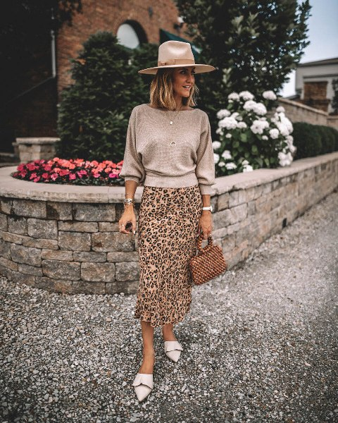 With beige hat, leopard printed midi skirt, bag and white mules