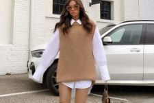 With beige leather skinny pants, bag, oversized sunglasses and beige suede mid calf boots