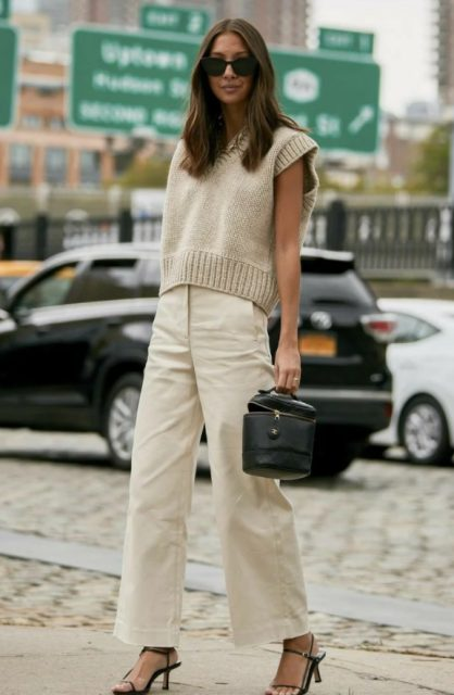 With beige loose pants, black leather bag and black ankle strap shoes