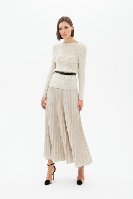 With black belt, pleated midi skirt and black and beige ankle strap high heels