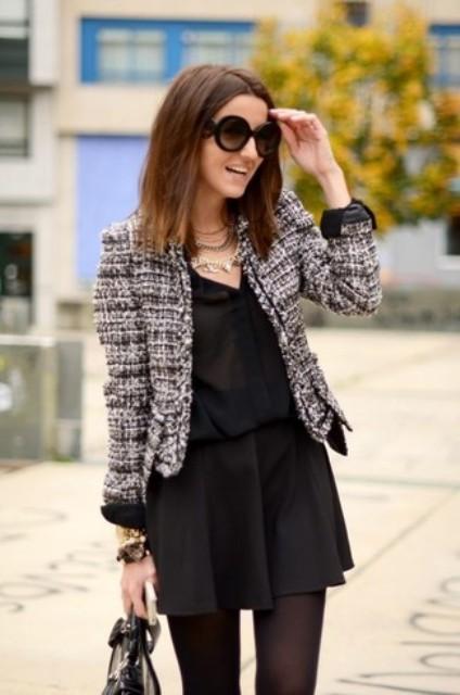 With black button down shirt, black mini skirt and bag