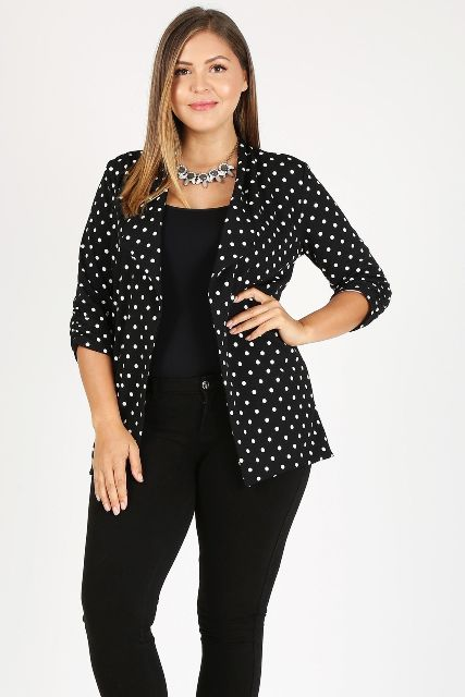 With black fitted top, black pants and necklace