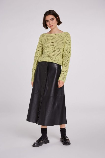 With black leather button front midi skirt and black leather flat shoes