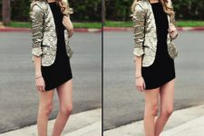 With black mini dress and black embellished ankle boots