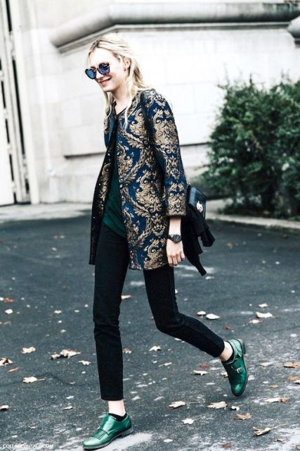 With black pants, green shirt, green flat shoes and bag
