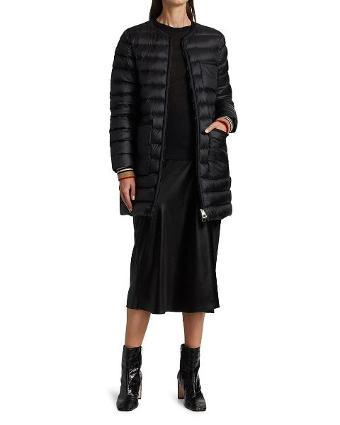 With black sweater, black midi skirt and black patent leather mid calf boots