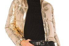 With black turtleneck, gray jeans, black belt and black bag