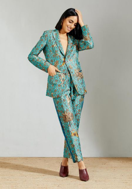 With brocade trousers and marsala leather heeled mules