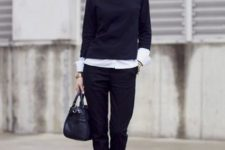 With classic black trousers, black leather bag and black pumps