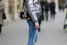 With cropped jeans, black lace up boots and black bag