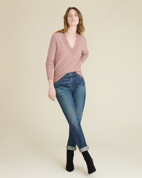 With cuffed jeans and black mid calf boots