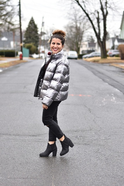With dark gray cropped jeans and black ankle boots